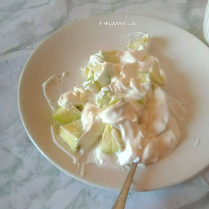 healthy cottage cheese snack mixed with pieces of fruit
